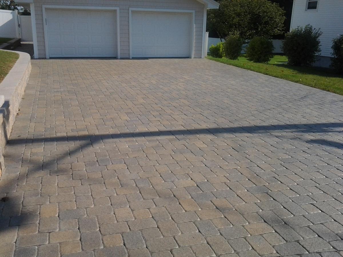 Driveway & patio paver resembling rustic rectangular cobblestone.