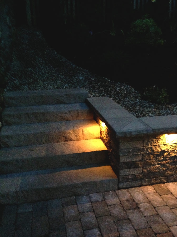 lighted patio steps, block wall with lights