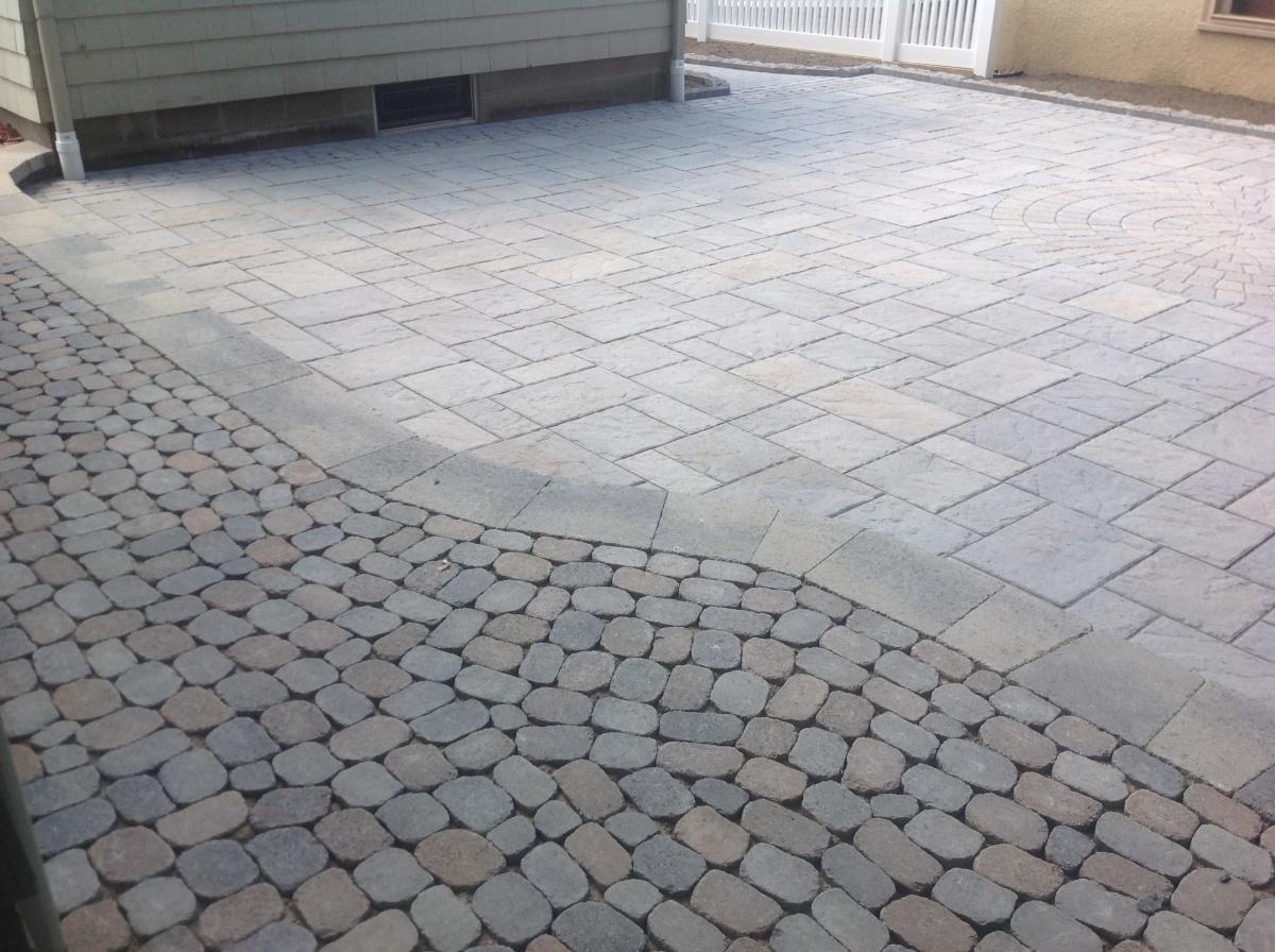 Unique shaped paver stone walkway.