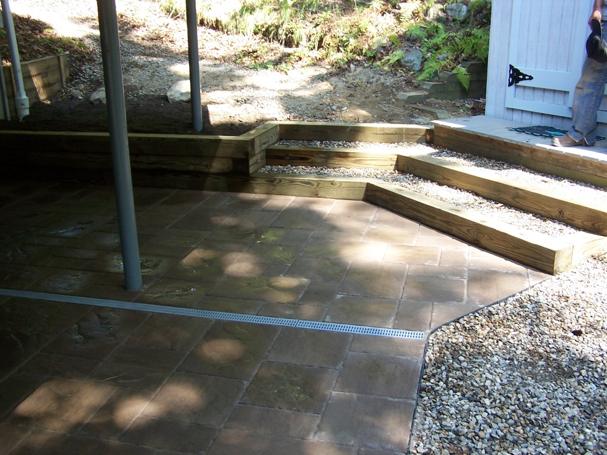 Channel drain in patio. Timber steps installed.