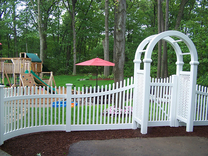 Vinyl Spindle Fence with Gated Arbor, Lexington, MA