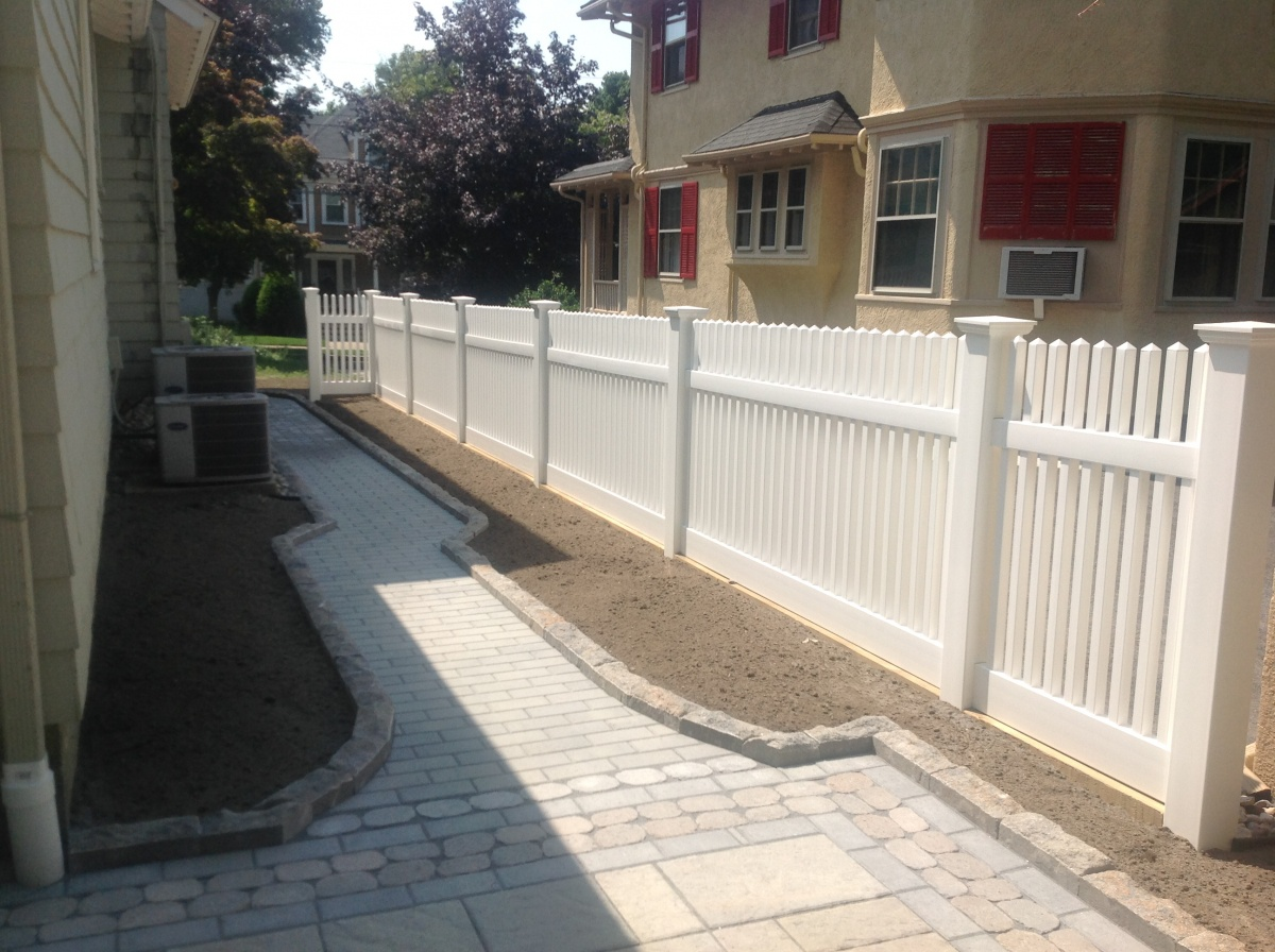 Open vinyl fencing, block design walkway with edging.