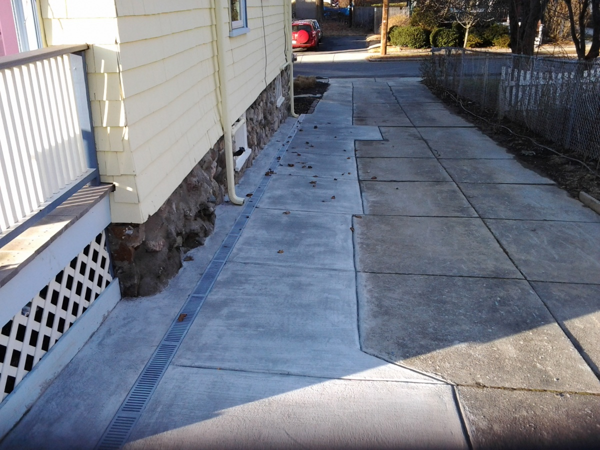 Channel drain, drains run-off away from foundation.