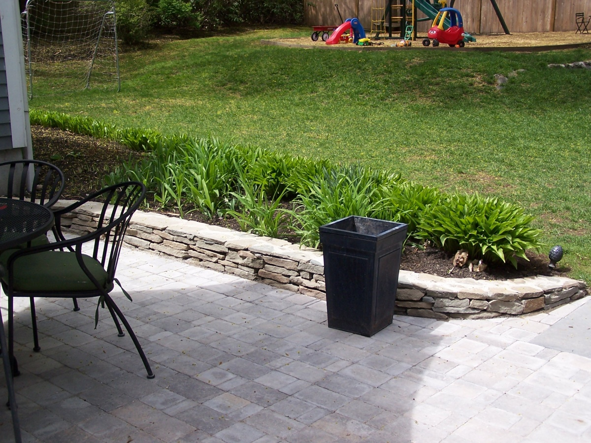 Patio with Natural Flat fieldstone garden wall