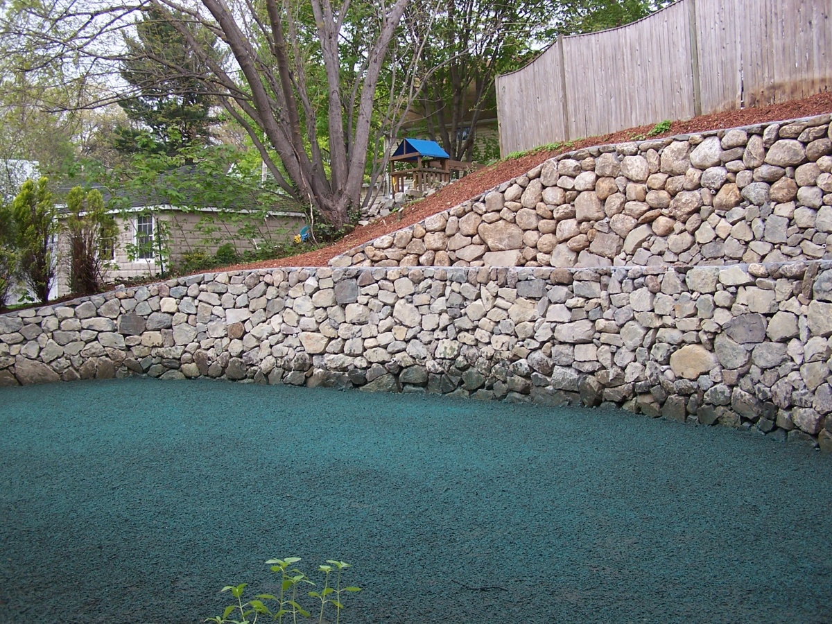 Natural fieldstone wall with dry-stack look.