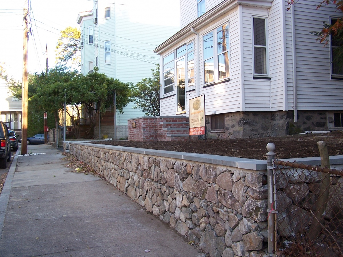 Natural fieldstone wall with dry-stack look