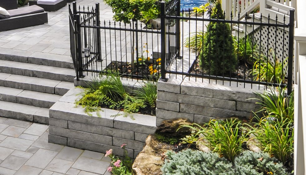 rock wall and metal fence