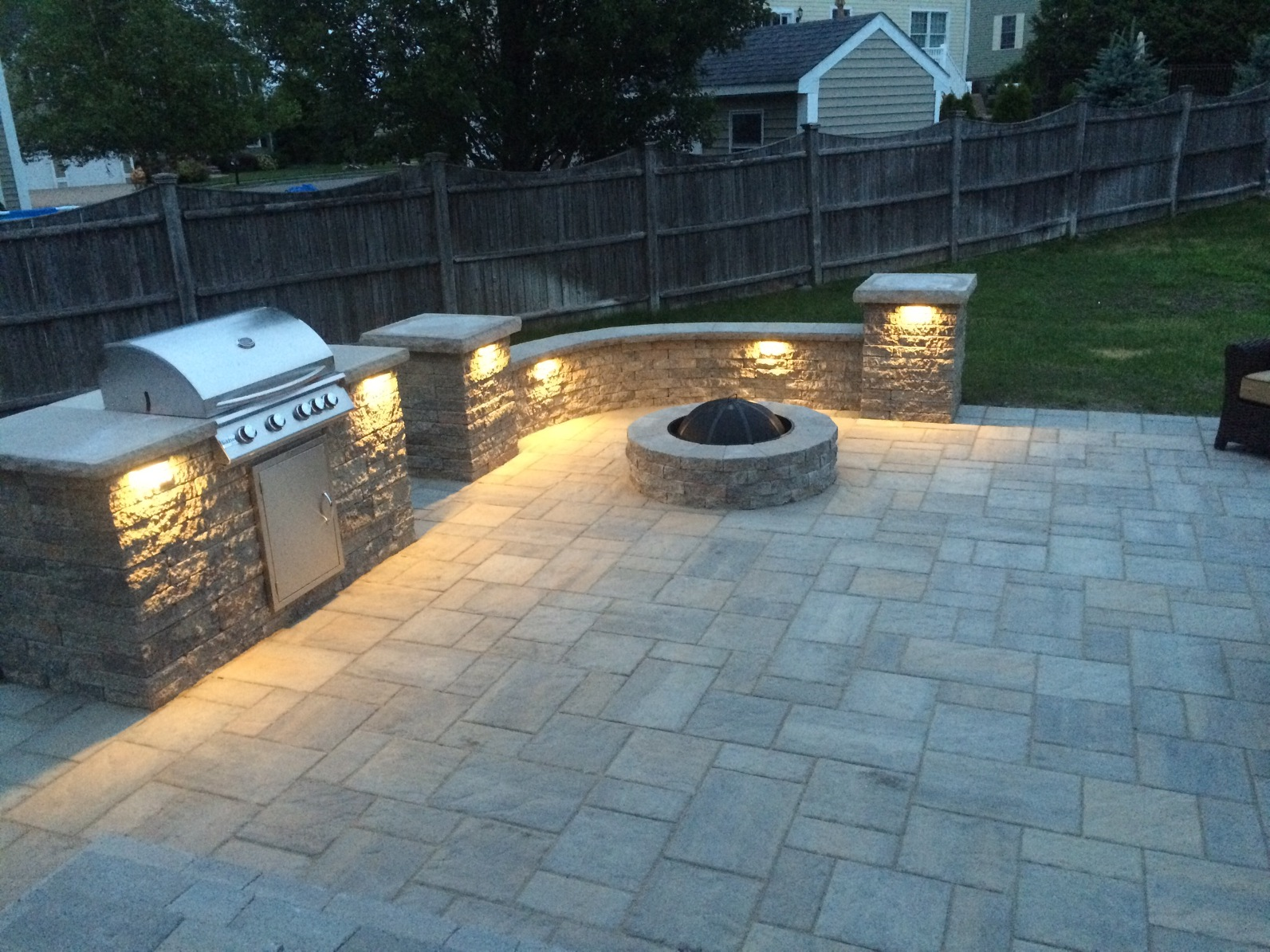 Outdoor kitchen, patio with under counter lighting.