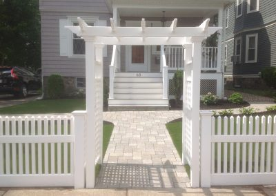 White arbor and fence.